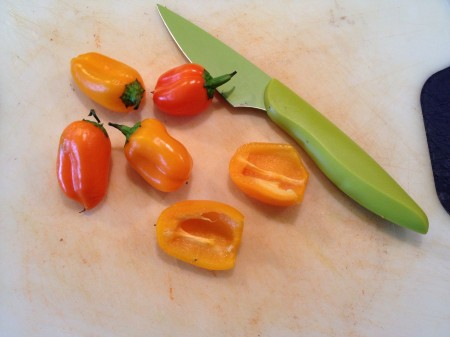 slice sweet chili peppers in half and remove seeds